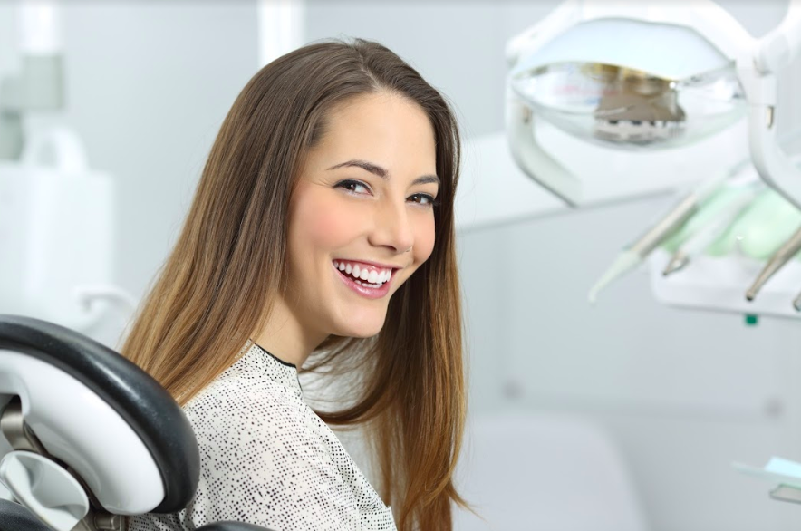 woman smiling with bright teeth at dentist office