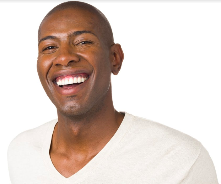man with open smile with straight white teeth